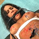 Model in trouble  hot girl is tortured and scalded with burning wax. Hot girl is anguished and scalded with burning wax
