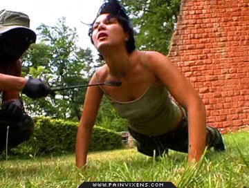 Drill sergeant0  violent instructor physically dominates his weak trainee. Massive instructor physically dominates his weak trainee