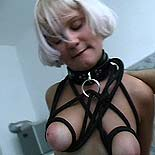 Pleasing her master  a blonde slave is roughed up at the hands of her perverted task master. A blonde slave is roughed up at the hands of her depraved task master