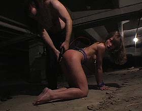 Anguished terror  kinky couple indulges in extreme bondage in an abandoned subway tunnel. Kinky couple indulges in extreme bondage in an abandoned subway tunnel