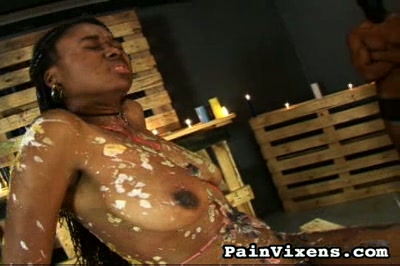 Silent pain. Great Titted ebony beauty gets her nipples coated in burning wax